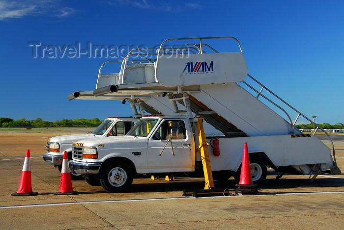 dominican199: Punta Cana, Dominican Republic: AVIAM ground services passenger boarding stairs (air-stairs) on Ford F-380 trucks - Punta Cana International Airport - PUJ / MDPC - photo by M.Torres - (c) Travel-Images.com - Stock Photography agency - Image Bank