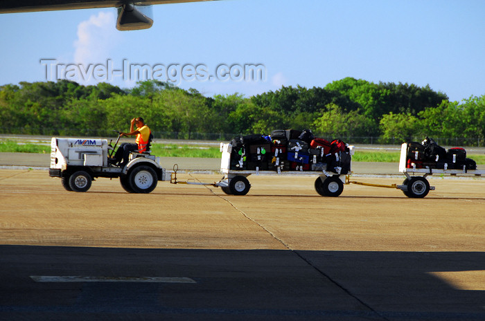 dominican203: Punta Cana, Dominican Republic: baggage train - TUG Technologies Corporation MA Tow Tractor - Punta Cana International Airport - PUJ / MDPC - photo by M.Torres - (c) Travel-Images.com - Stock Photography agency - Image Bank