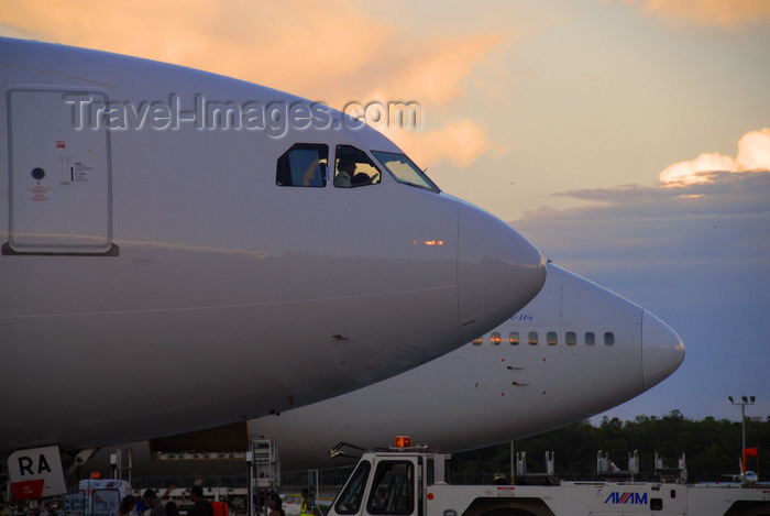 dominican209: Punta Cana, Dominican Republic: aircraft noses - Airbus A330-200 and Boeing 747-341 - Punta Cana International Airport - PUJ / MDPC - photo by M.Torres - (c) Travel-Images.com - Stock Photography agency - Image Bank