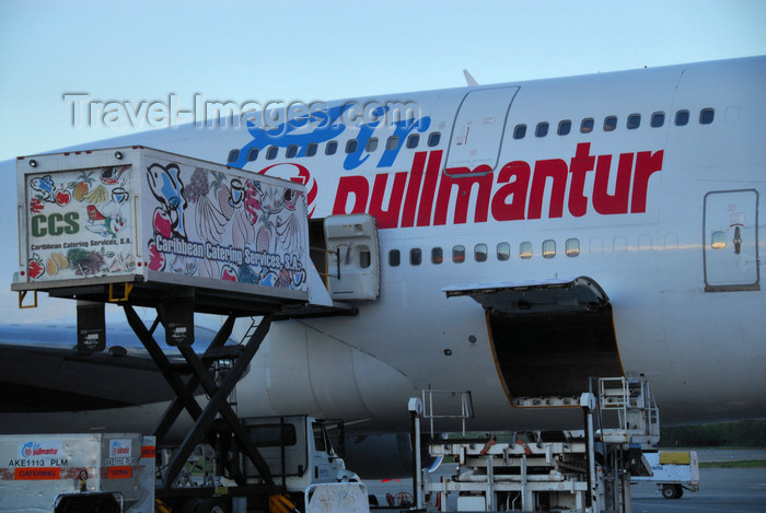 dominican211: Punta Cana, Dominican Republic: Air Pullmantur Boeing 747-341 EC-IOO - catering truck and open baggage hold / cargo bin - Punta Cana International Airport - PUJ / MDPC - photo by M.Torres - (c) Travel-Images.com - Stock Photography agency - Image Bank