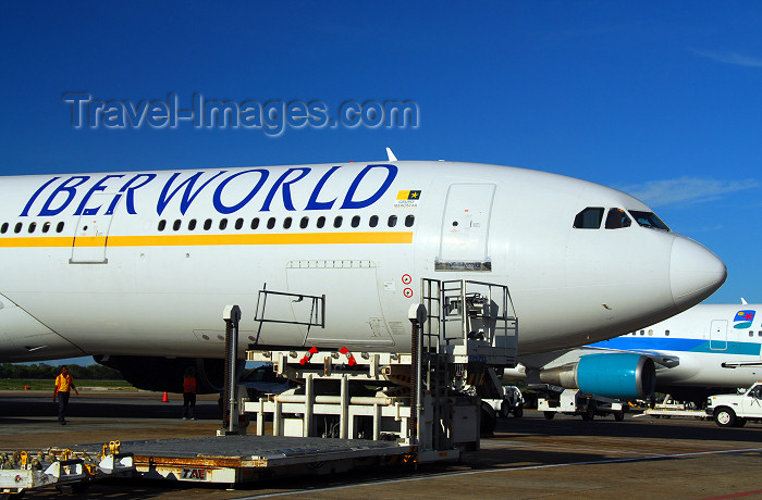 dominican217: Punta Cana, Dominican Republic: Iberworld Airbus A330-322 EC-IJH and Ground Support Equipment - Punta Cana International Airport - PUJ / MDPC - photo by M.Torres - (c) Travel-Images.com - Stock Photography agency - Image Bank