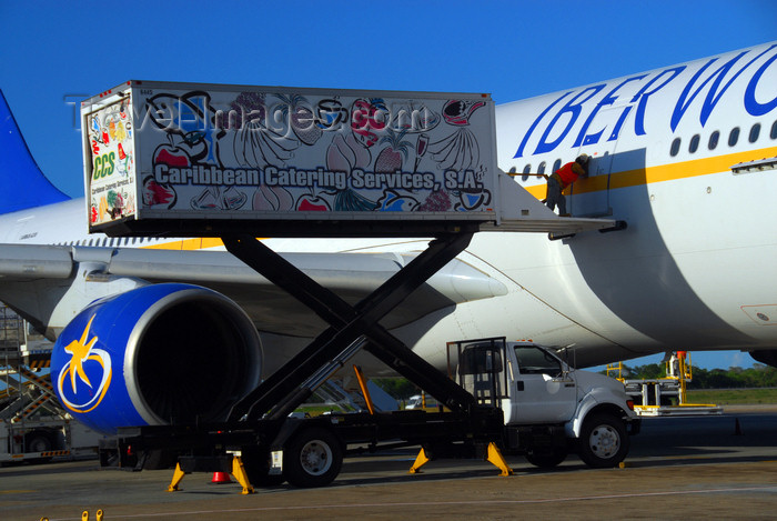 dominican219: Punta Cana, Dominican Republic: Iberworld Airbus A330-322 EC-IJH - catering vehicle lifting its cargo - Caribbean Catering Services - Punta Cana International Airport - PUJ / MDPC - photo by M.Torres - (c) Travel-Images.com - Stock Photography agency - Image Bank