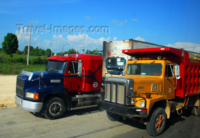 dominican227: La Romana, Dominican Republic: American trucks head to San Domingo - Mack and International - photo by M.Torres - (c) Travel-Images.com - Stock Photography agency - Image Bank