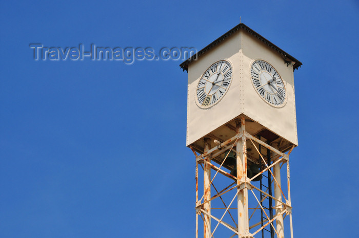 dominican256: Monte Cristi, Dominican Republic: Public clock, facing the four cardinal directions - Plaza Duarte - photo by M.Torres - (c) Travel-Images.com - Stock Photography agency - Image Bank