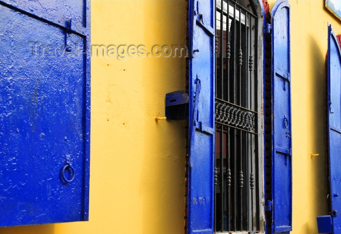 dominican282: Puerto Plata, Dominican republic: yellow wall and windows with blue shutters - photo by M.Torres - (c) Travel-Images.com - Stock Photography agency - Image Bank