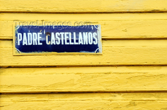 dominican293: Puerto Plata, Dominican republic: street sign on yellow wall - Calle Padre Castellanos - photo by M.Torres - (c) Travel-Images.com - Stock Photography agency - Image Bank