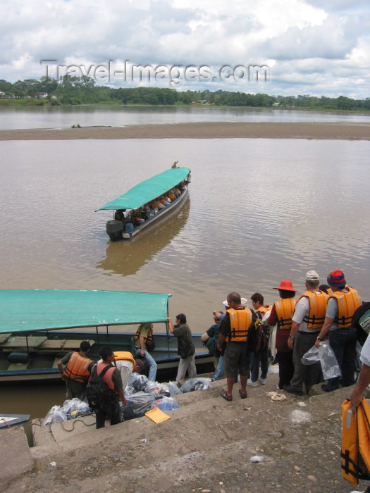 ecuador16: Ecuadorian Amazonia: tourists in lifejackets board their boat - Pastaza River (photo by Rod Eime) - (c) Travel-Images.com - Stock Photography agency - Image Bank