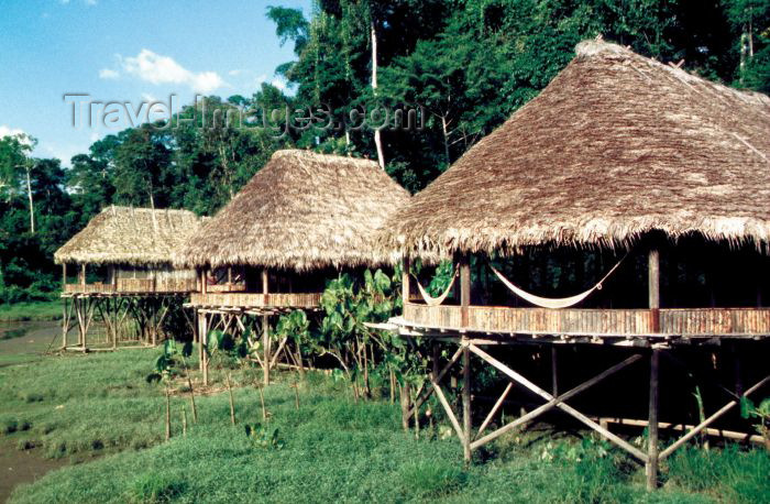 ecuador17: Ecuadorian Amazonia: cabans on stilts and with hammocks - Kapawi camp (photo by Rod Eime) - (c) Travel-Images.com - Stock Photography agency - Image Bank