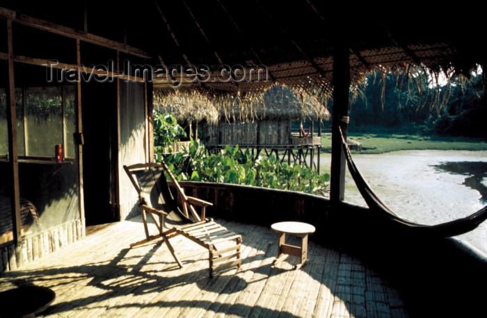 ecuador22: Ecuadorian Amazonia: Kapawi camp - verandah with hammock - Ecolodge and Reserve (photo by Rod Eime) - (c) Travel-Images.com - Stock Photography agency - Image Bank