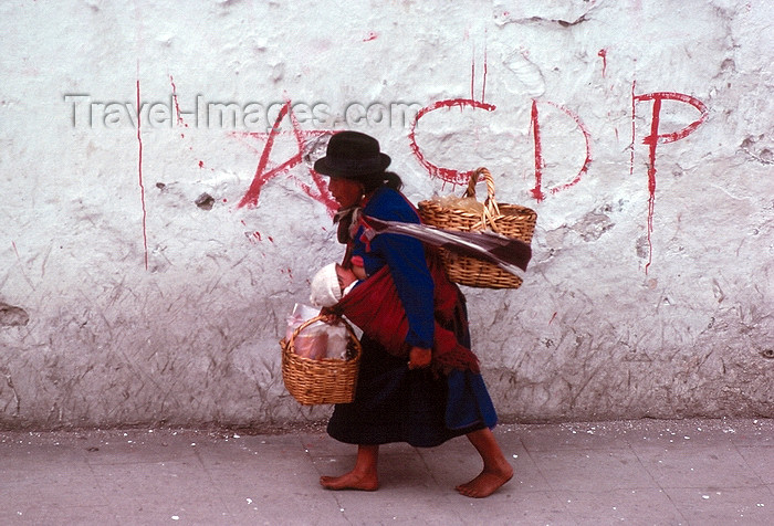 ecuador36:  Ecuador - Quito: Indian woman with child and baskets  - street with CDP graffiti - photo by J.Fekete - (c) Travel-Images.com - Stock Photography agency - Image Bank