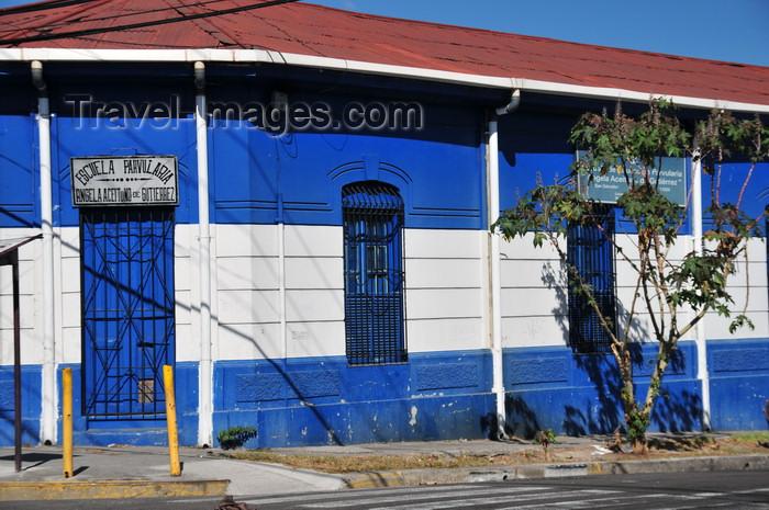 el-salvador5: San Salvador, El Salvador, Central America: school building in the colors of the Salvadoran flag - Escuela Parvularia - 17a Av Sur - photo by M.Torres - (c) Travel-Images.com - Stock Photography agency - Image Bank