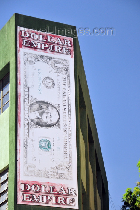 el-salvador67: San Salvador, El Salvador, Central America: Dollar empire shop - giant one dollar bill at 6a calle poniente - photo by M.Torres - (c) Travel-Images.com - Stock Photography agency - Image Bank