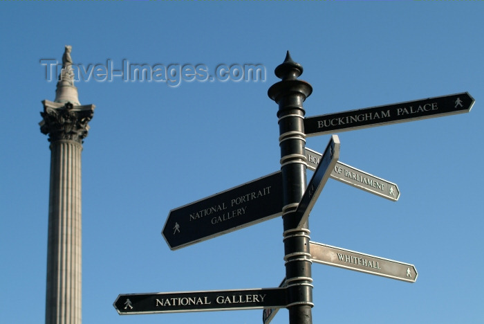 england221: London: Nelson's columns and sign post - Trafalgar square - photo by K.White - (c) Travel-Images.com - Stock Photography agency - Image Bank