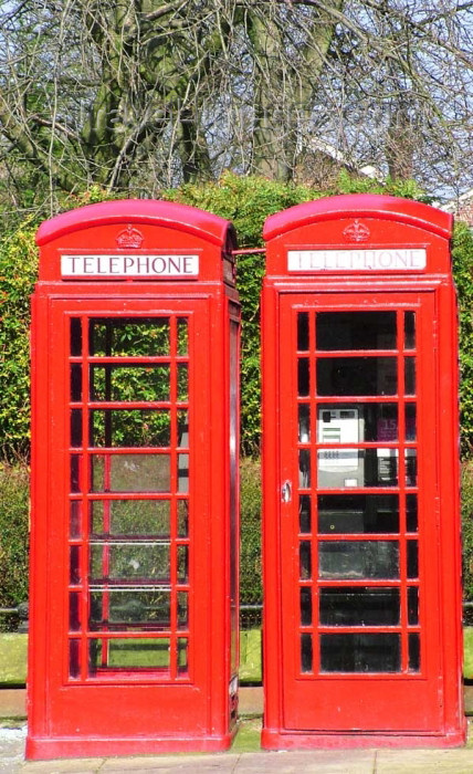 england302: Warrington, Cheshire, England, UK: twin Telephone Boxes, Sankey Street - public phones - phone booths - quintessential British red phone box, designed by Sir Giles Gilbert Scott, English architect - K6 - photo by D.Jackson - (c) Travel-Images.com - Stock Photography agency - Image Bank