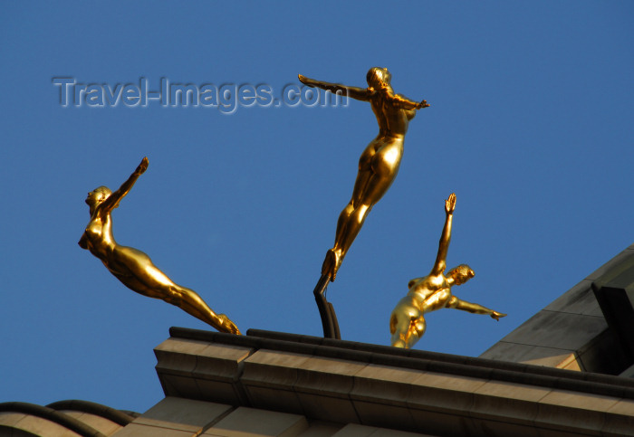 england459: London, England: gilded synchronised divers - sculpture 'Three Graces' by Rudy Weller - roof of the Criterion Building - Piccadilly Circus - photo by Miguel Torres - (c) Travel-Images.com - Stock Photography agency - Image Bank