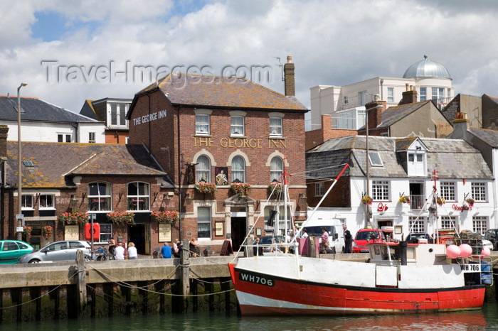 england561: Weymouth, Dorset, England: fishing boat and the George Inn - photo by I.Middleton - (c) Travel-Images.com - Stock Photography agency - Image Bank