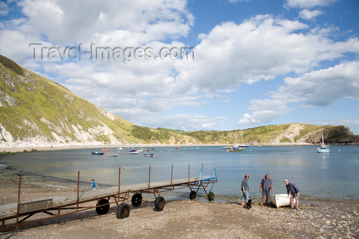 england571: Lulworth Cove, Dorset, England: men dragging boat up beach - photo by I.Middleton - (c) Travel-Images.com - Stock Photography agency - Image Bank