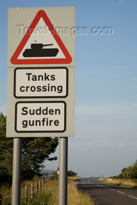 england577: Lulworth to Wareham road, Dorset, England: warning sign for tanks crossing and sudden gunfire - photo by I.Middleton - (c) Travel-Images.com - Stock Photography agency - Image Bank