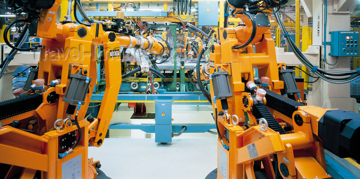 england643: Cowley, Oxfordshire, South East England: robots in a car factory - German KUKA Industrial robots - Industrial Robotics in car production - photo by A.Bartel - (c) Travel-Images.com - Stock Photography agency - Image Bank