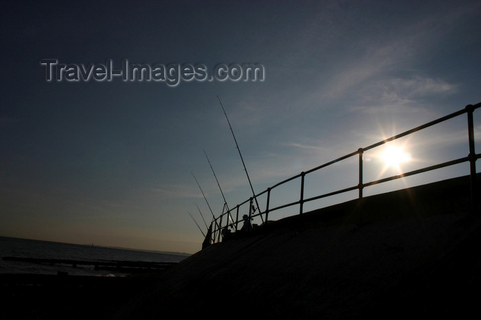 england657: Lee on Solent, Gosport, Hampshire, South East England, UK: fishermen fishing off seafront as sun goes down - photo by I.Middleton - (c) Travel-Images.com - Stock Photography agency - Image Bank