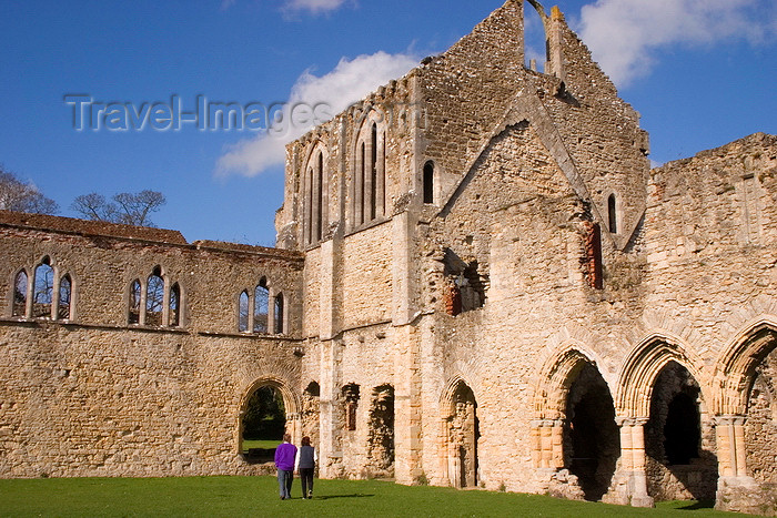 england665: Netley, Hampshire, South East England, UK: Netley Abbey - couple holding hands walking towards ruins - cloister showing the south transept of the church and the east range - photo by I.Middleton - (c) Travel-Images.com - Stock Photography agency - Image Bank