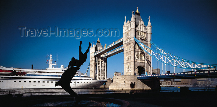 england769: London, England: Tower Bridge open for MV Seabourn Pride 5-star cruise ship and 'Girl with a Dolphin' sculpture by David Wynne - photo by A.Bartel - (c) Travel-Images.com - Stock Photography agency - Image Bank