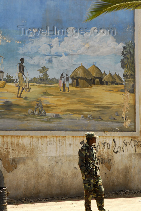 eritrea14: Eritrea - Asmara: soldier in front of a mural with a village scene - photo by E.Petitalot - (c) Travel-Images.com - Stock Photography agency - Image Bank