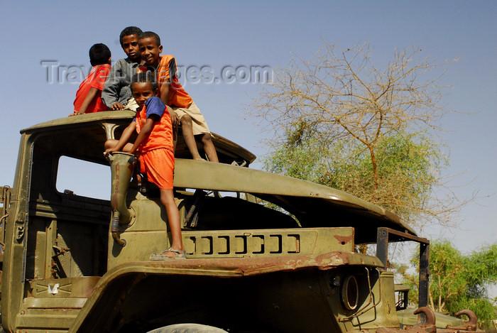 eritrea43: Eritrea - Keren, Anseba region: boys playing on a rusting Soviet truck - photo by E.Petitalot - (c) Travel-Images.com - Stock Photography agency - Image Bank
