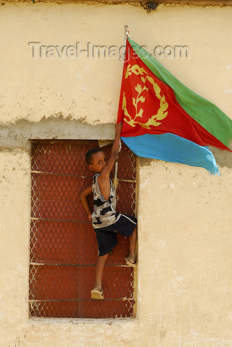 eritrea60: Eritrea - Hagaz, Anseba region - boy placing the flag of Eritrea on a house - photo by E.Petitalot - (c) Travel-Images.com - Stock Photography agency - Image Bank