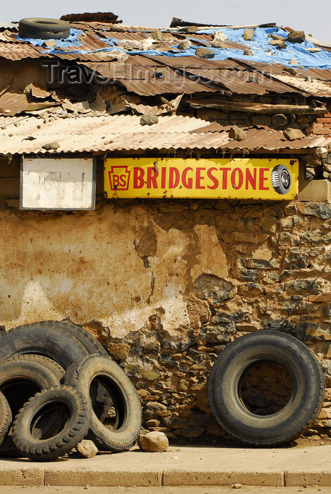 eritrea85: Eritrea - Mendefera, Southern region: an old tyre shop - Bridgestone sign - photo by E.Petitalot - (c) Travel-Images.com - Stock Photography agency - Image Bank