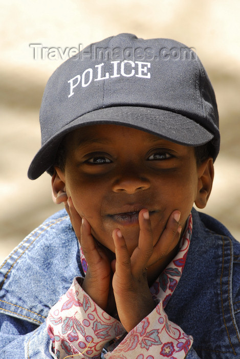 eritrea9: Eritrea - Asmara: smilling boy with a police cap - photo by E.Petitalot - (c) Travel-Images.com - Stock Photography agency - Image Bank
