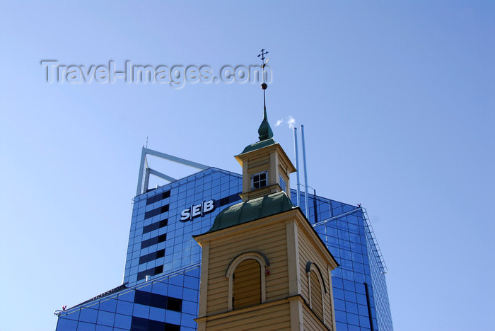 estonia195: Estonia, Tallinn: Old wooden church spire in front of new skyscraper - SEB - photo by J.Pemberton - (c) Travel-Images.com - Stock Photography agency - Image Bank