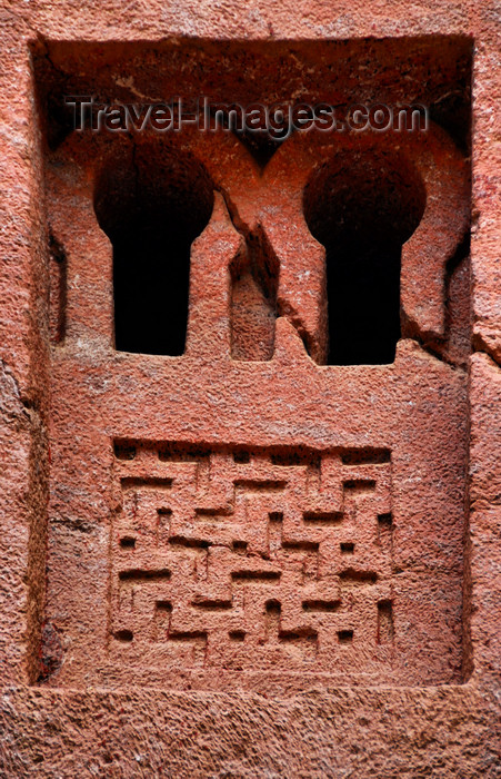 ethiopia156: Lalibela, Amhara region, Ethiopia: Bet Medhane Alem rock-hewn church - window with geometrical motives - photo by M.Torres - (c) Travel-Images.com - Stock Photography agency - Image Bank