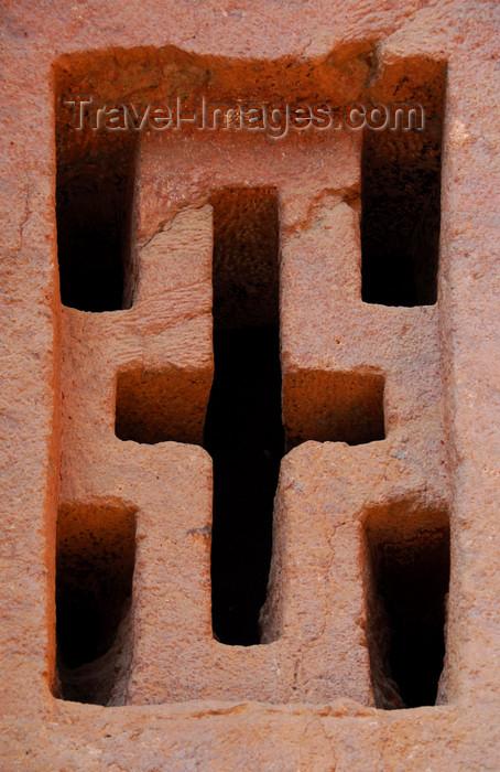 ethiopia159: Lalibela, Amhara region, Ethiopia: Bet Medhane Alem rock-hewn church - cruciform window - photo by M.Torres - (c) Travel-Images.com - Stock Photography agency - Image Bank