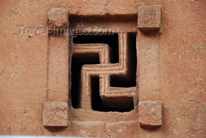 ethiopia165: Lalibela, Amhara region, Ethiopia: Bet Maryam rock-hewn church - swastika window - photo by M.Torres - (c) Travel-Images.com - Stock Photography agency - Image Bank