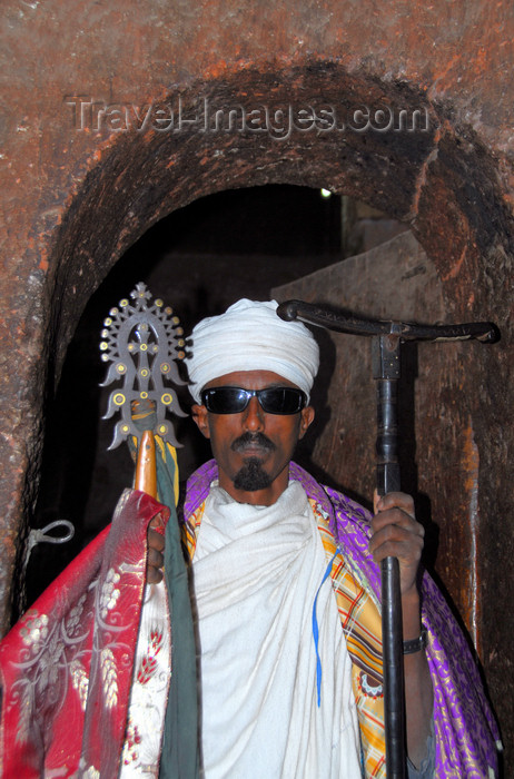 ethiopia173: Lalibela, Amhara region, Ethiopia: Bet Mikael church - Coptic priest with cross and mequamia praying stick - photo by M.Torres - (c) Travel-Images.com - Stock Photography agency - Image Bank
