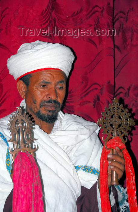 ethiopia187: Lalibela, Amhara region, Ethiopia: Bet Giyorgis rock-hewn church - priest with crosses - UNESCO world heritage site - photo by M.Torres - (c) Travel-Images.com - Stock Photography agency - Image Bank