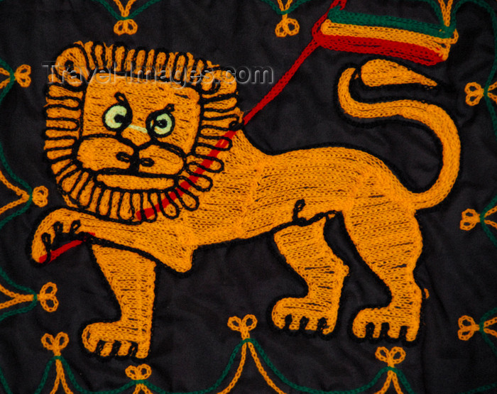 ethiopia197: Lalibela, Amhara region, Ethiopia: Lion of Judah with Ethiopian flag - textile - photo by M.Torres - (c) Travel-Images.com - Stock Photography agency - Image Bank