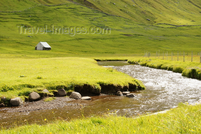 faeroe12: Elduvik village, Eysturoy island, Faroes: small house, stream and grass fields - photo by A.Ferrari - (c) Travel-Images.com - Stock Photography agency - Image Bank