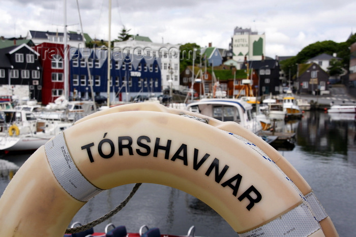 faeroe120: Tórshavn, Streymoy island, Faroes: lifebuoy  in the and the east harbour, Eystaravág - Tórshavnar - Tinganes in the background - photo by A.Ferrari - (c) Travel-Images.com - Stock Photography agency - Image Bank