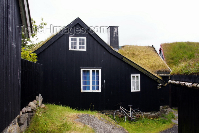 faeroe128: Tórshavn, Streymoy island, Faroes: bike and Faroese sod roofed houses of Tinganes - photo by A.Ferrari - (c) Travel-Images.com - Stock Photography agency - Image Bank