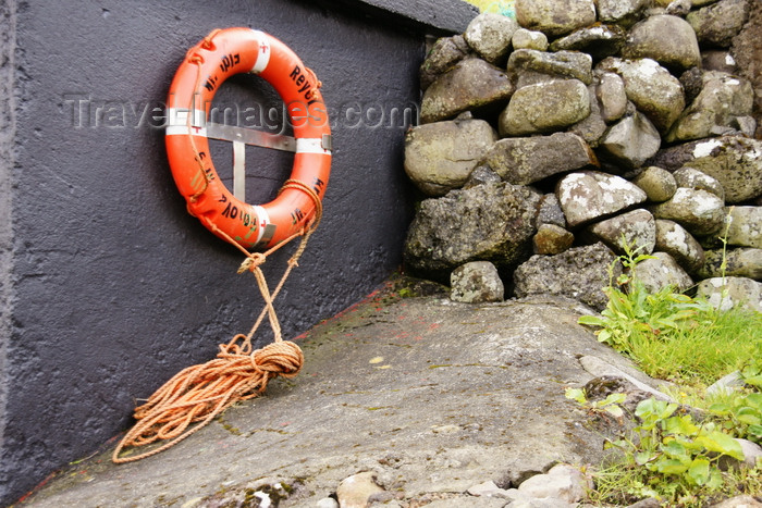 faeroe31: Elduvik village, Eysturoy island, Faroes: lifebuoy and stone wall - photo by A.Ferrari - (c) Travel-Images.com - Stock Photography agency - Image Bank