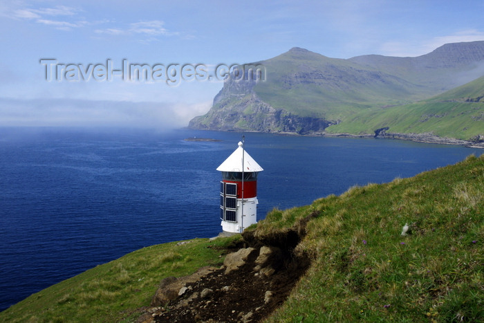 faeroe77: Sørvágsfjørður fjord, Vágar island, Faroes: lighthouse perched over the sea - solar power operated - photo by A.Ferrari - (c) Travel-Images.com - Stock Photography agency - Image Bank