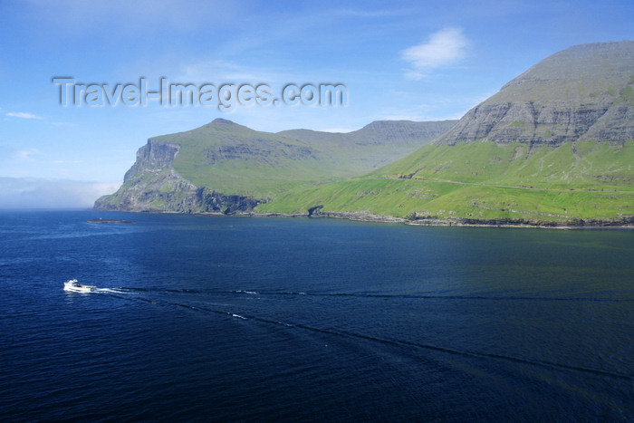 faeroe78: Sørvágsfjørður fjord, Vágar island, Faroes: a fishing boat leaves for the ocean - bow waves - photo by A.Ferrari - (c) Travel-Images.com - Stock Photography agency - Image Bank