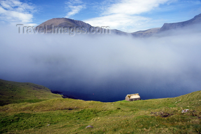 faeroe80: Sørvágsfjørður fjord, Vágar island, Faroes: fog and cottage on the cliff edge - photo by A.Ferrari - (c) Travel-Images.com - Stock Photography agency - Image Bank