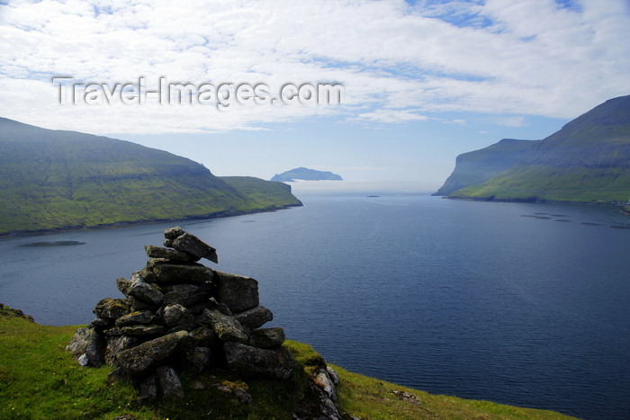 faeroe83: Sørvágsfjørður fjord, Vágar island, Faroes: cairn on the cliff edge - photo by A.Ferrari - (c) Travel-Images.com - Stock Photography agency - Image Bank