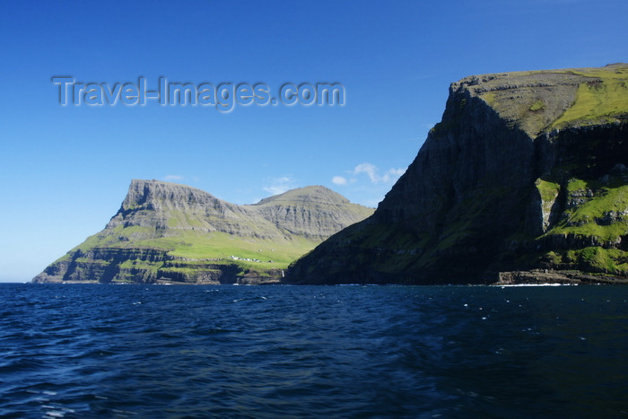 faeroe87: Vágar island, Faroes: coastal cliffs and Árnafjall mountain - below it the village of Gásadalur - photo by A.Ferrari - (c) Travel-Images.com - Stock Photography agency - Image Bank