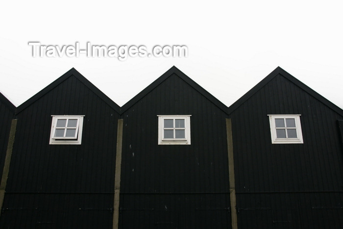 faeroe9: Norðragøta village, Eysturoy island, Faroes: black boat houses in the harbour - photo by A.Ferrari - (c) Travel-Images.com - Stock Photography agency - Image Bank