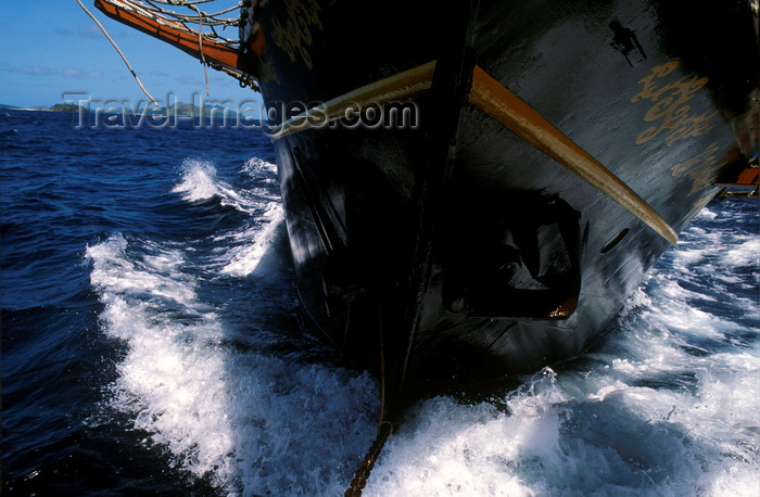 fiji15: Yasawa Islands, Fiji: top sail schooner La Violante, built in the 1920's breaks through the waters - prow close-up - photo by C.Lovell - (c) Travel-Images.com - Stock Photography agency - Image Bank