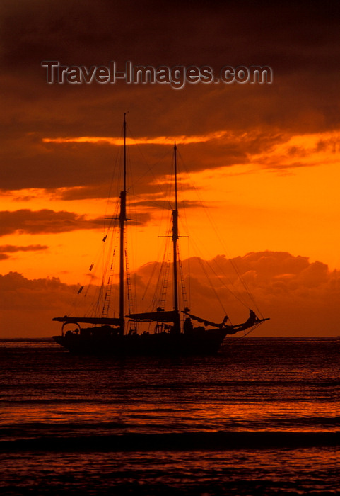fiji35: Yasawa Islands, Fiji: orange sunset with cloud cover over the Pacific Ocean – silhouette of La Violante, a 1920s double-masted schooner - photo by C.Lovell - (c) Travel-Images.com - Stock Photography agency - Image Bank